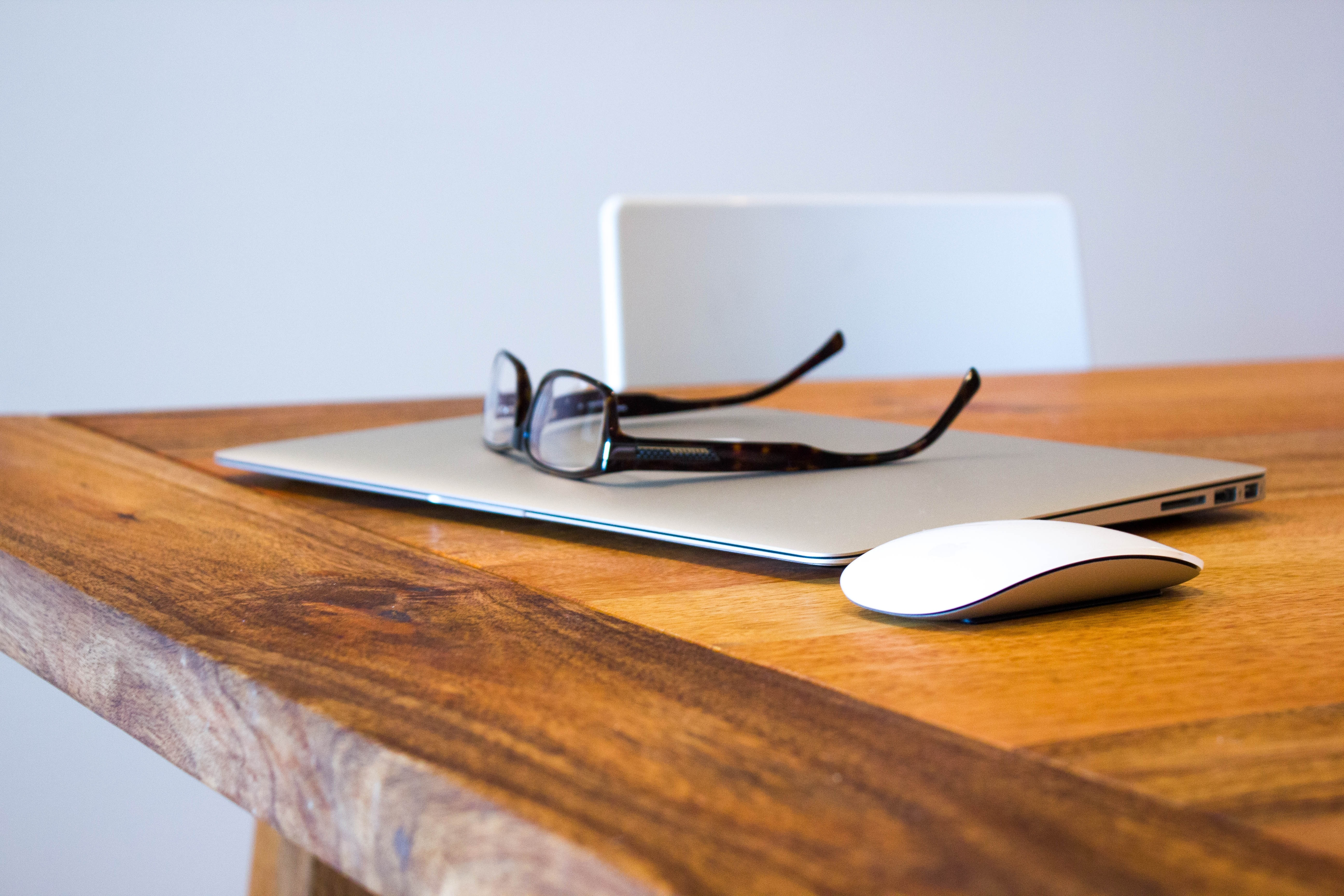 laptop and reading glasses retirement planning